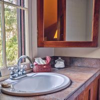 The bathroom of Lodge Room #2 looks out over the treetops for plenty of light and privacy