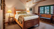 Lodge Room #4 is a quaint room with a historic lodge feel
