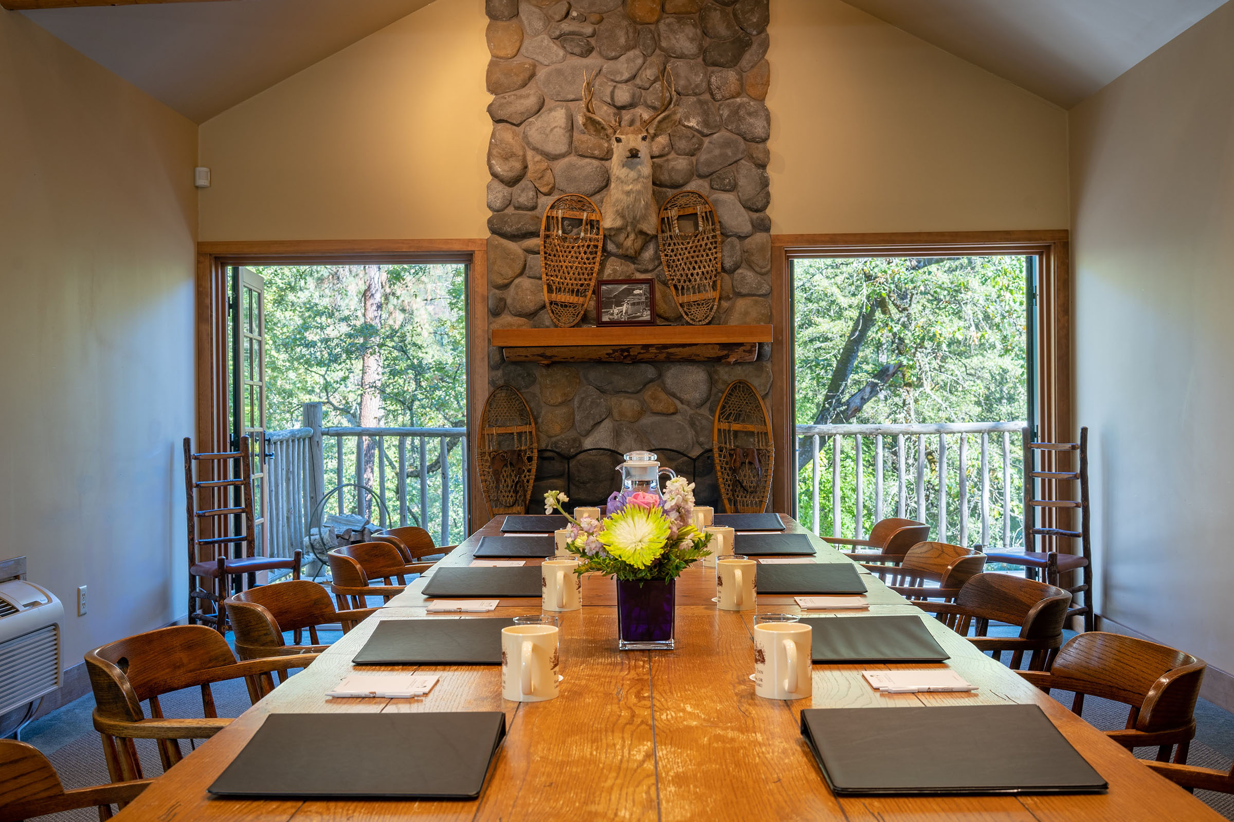 The boardroom interior maintains the rustic lodge atmosphere